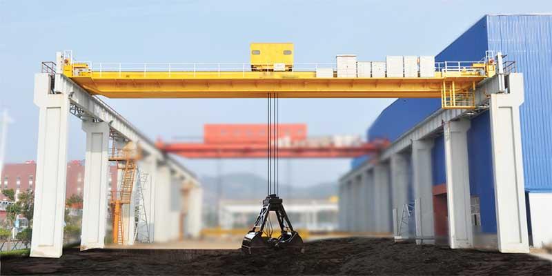 Мостовой грейферный кран фото